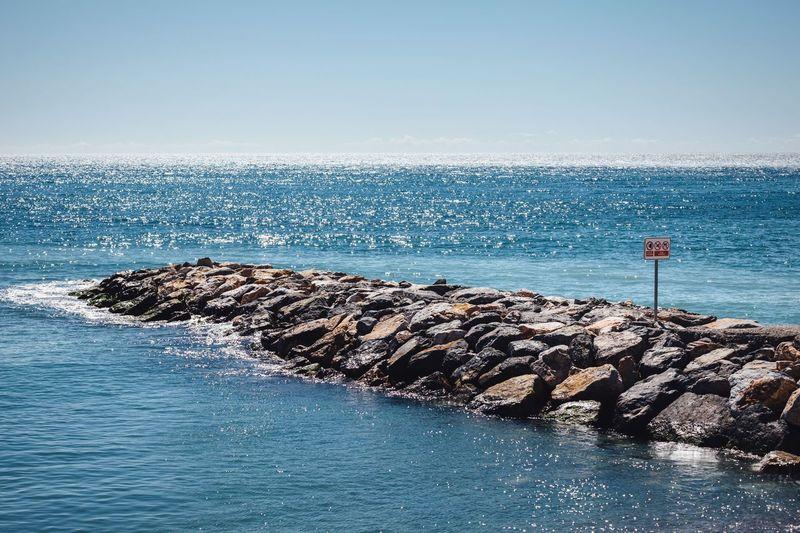 Rocky pier in sea