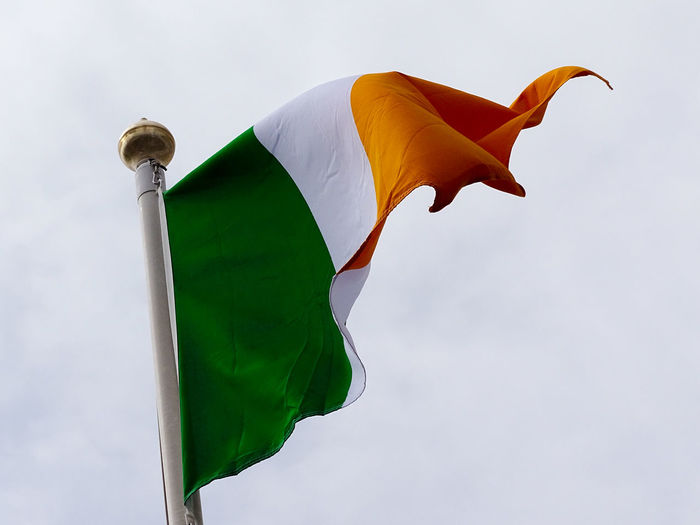 Low angle view of angel irish flag against sky