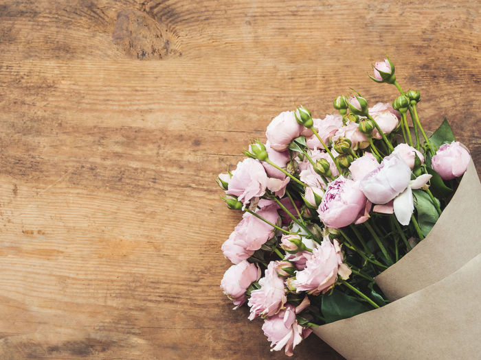 High angle view of pink roses on table
