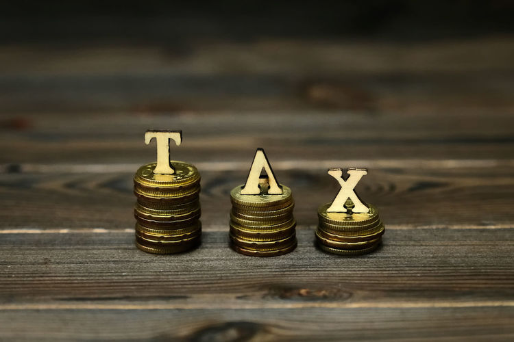 TAX CONCEPTUAL WITH STACKED COIN Income Tax Return