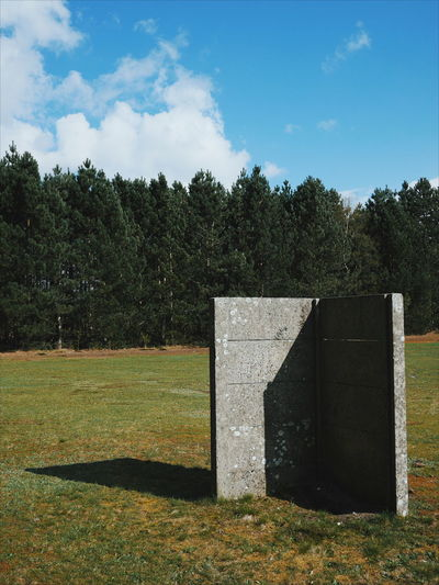 Concrete Wall On Grassy Field