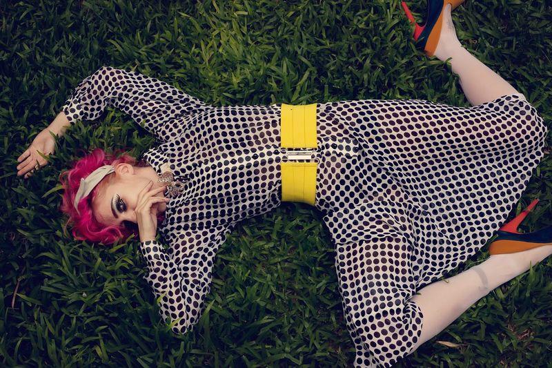 Portrait of woman lying on grass