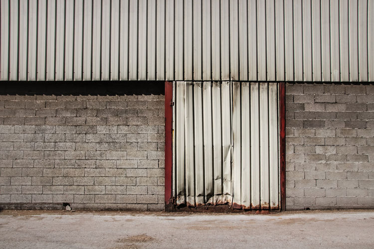 Architecture Wall - Building Feature Industry Wall Entrance Warehouse Built Structure Backgrounds No People Door Brick Iron Domestic Room Corrugated Iron Metal Closed Building Building Exterior City Brick Wall Dirty Outdoors Concrete Garage Corrugated The Minimalist - 2019 EyeEm Awards
