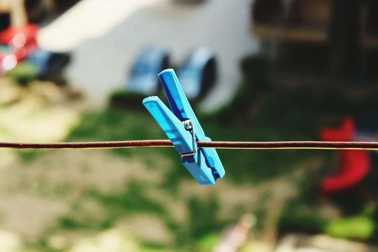 Close-Up Of Peg On Washing Line Against Blurred Background