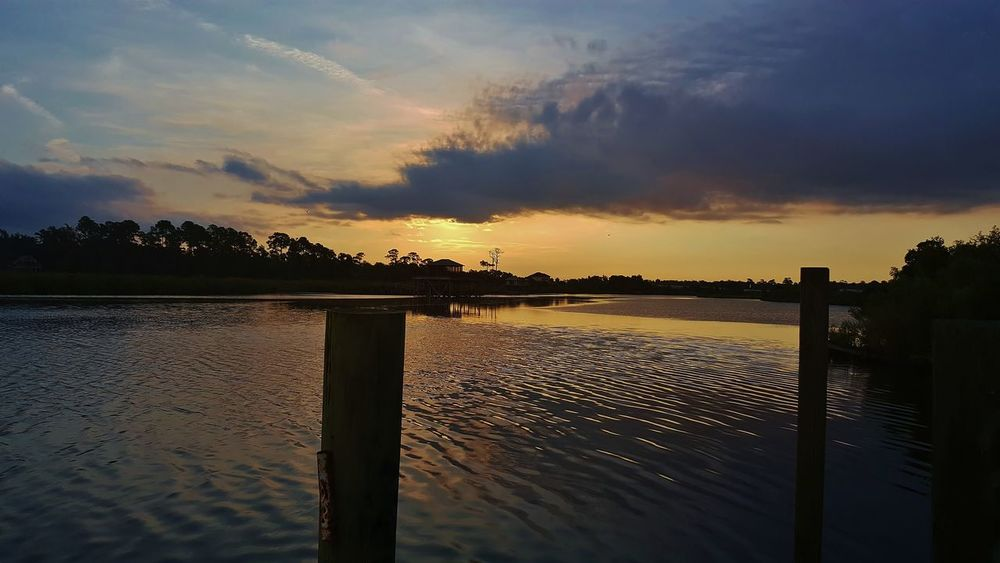 Bayou Of Mississippi Bayou View Beautiful Sky Beautiful Sunrise Beauty In Nature Clouds & Sky Goodmorning Mississippi  Mississippi Summer Nature No People Outdoors Reflection Ripples In The Water Sky Sunlight Sunset Tree Water Water_collection Waterfront