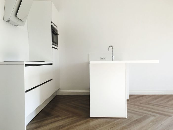 Indoors  Flooring No People White Color Wall - Building Feature Architecture Home Interior Empty Domestic Room Hardwood Floor Sunlight Copy Space Entrance Absence Home