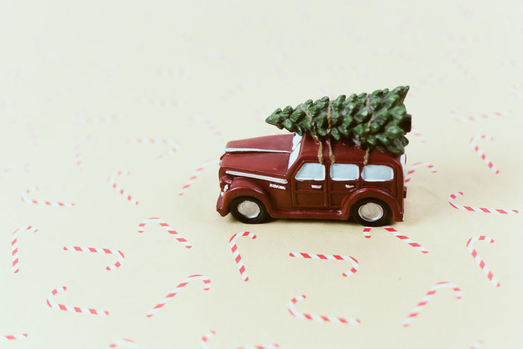 Close-up of toy car over white background
