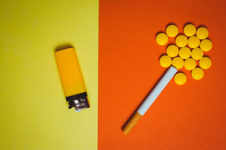 Yellow Indoors  No People Still Life Close-up Pencil Writing Instrument Orange Color Studio Shot Directly Above High Angle View Pen Colored Background Table Education Art And Craft Shadow Vibrant Color Creativity Office Supply Stapler Orange Background