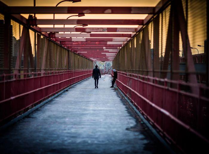 People Walking On Footbridge