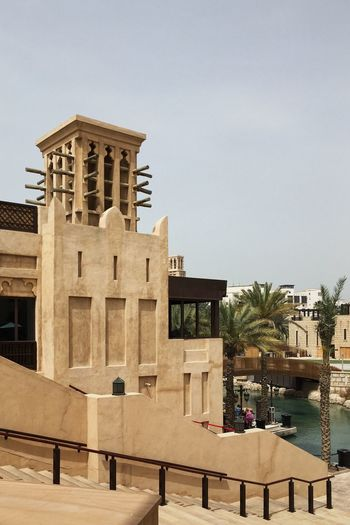 Souk Madinat Jumeirah. Dubai, UAE Arabian Arabic Arabic Architecture Arabic Style Architecture Building Exterior Built Structure Clear Sky Day Dubai Emirates Jumeirah Medinat Oasis Oazis Outdoors Sandy Sky Souk Travel Travel Destinations Travel Photography Traveling UAE Warm