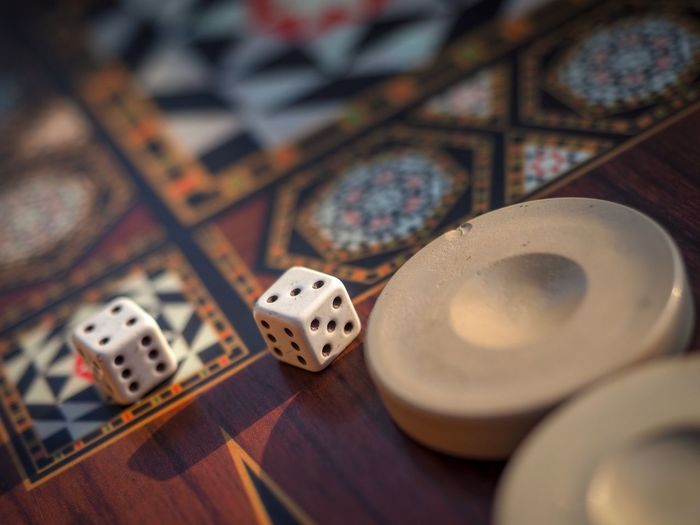 High angle view of dices on wooden table
