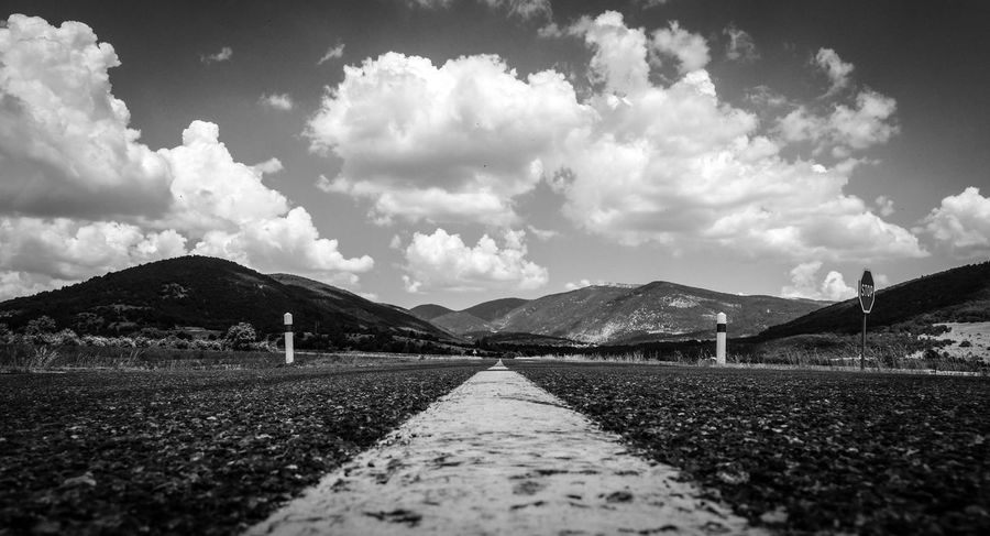 Asphalt Black And White Centered Cloud - Sky Country Road Endlessness EyeEm Best Shots - Black + White EyeEm Masterclass Forward France Freedom Frog Perspective From My Point Of View Lane Monochrome Mountain Range On The Road Provence Road Road Marking Roadmap Roadtrip Trip Way Forward Wormseyeview