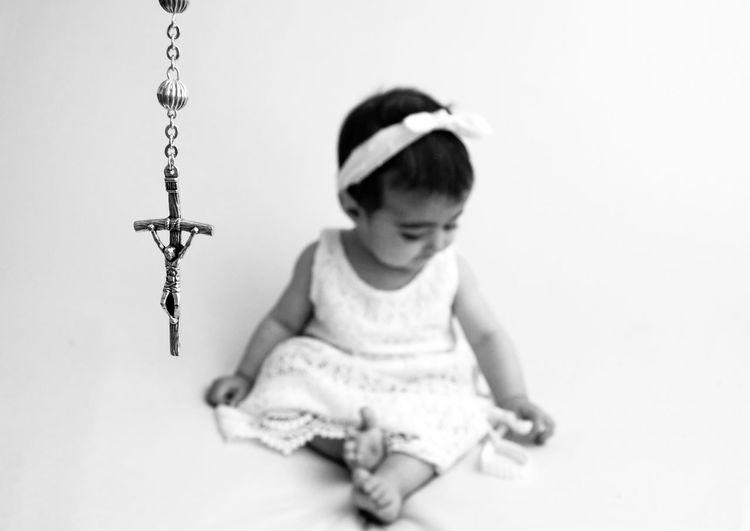 Cute girl sitting against white background