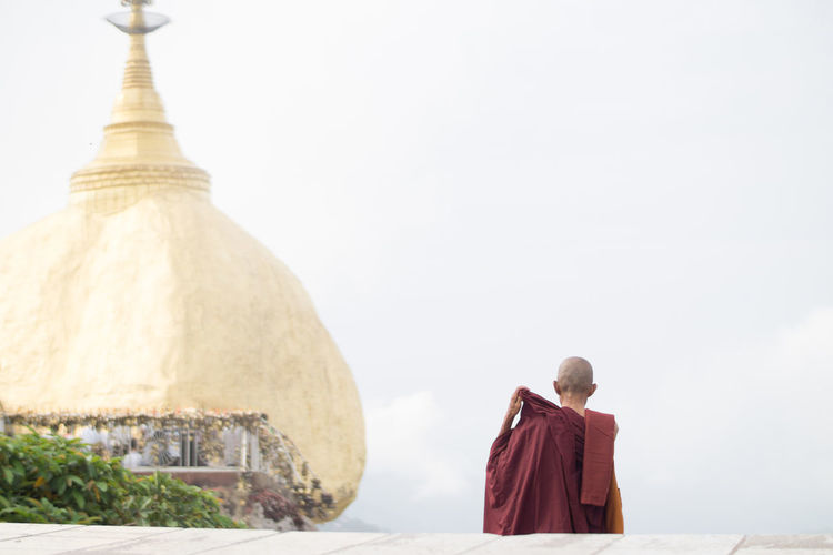 Religion Belief Architecture One Person Spirituality Built Structure Place Of Worship Rear View Traditional Clothing Sky Real People Clear Sky Copy Space Lifestyles Myanmar Myanmar Culture Monk  Golden Rock