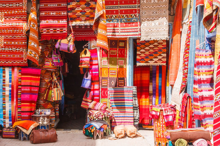Multi colored textiles for sale at market stall