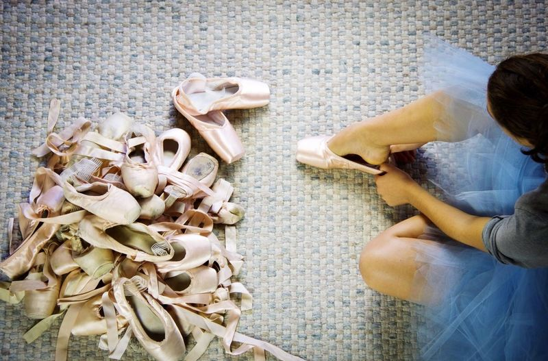 High Angle View Of Woman Wearing Ballet Shoe