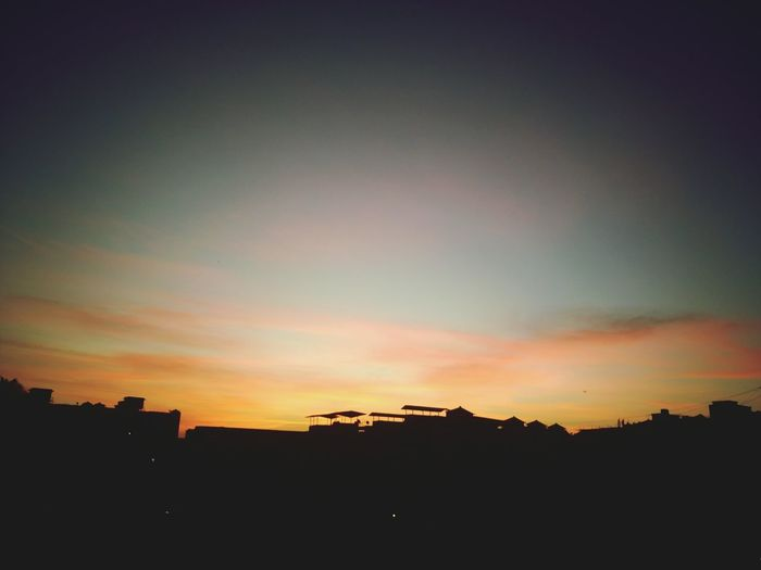 Sunset City Silhouette Building Exterior No People Cityscape Built Structure Outdoors Architecture Sky Beauty In Nature Urban Skyline Nature Travel Destinations Religion Air Vehicle