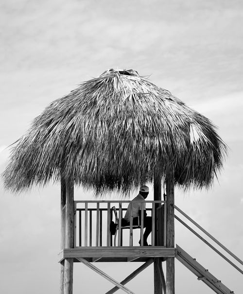 lifeguard Dominican Republic Sonya7II Hut Chair Monochrome Resort Blackandwhite Vacation Life Guard Post Thatched Roof Beach Tropical Climate Summer Togetherness Outdoors Vacations Sea Sky People Relaxation Day Adult Nature