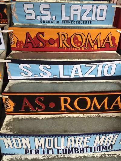 Rome, Italy - January 7, 2018: Fake AS Roma and Lazio football teams merchandising. AS Roma and SS Lazio S.p.A. are professional Italian football clubs based in Rome Merchandising Rome Supporters Advertisement As Roma Close-up Football Clubs No People Outdoors Scarves Ss Lazio