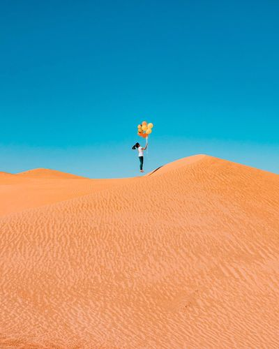 Desert Arid Climate Sand Dune Blue Sand Outdoors One Person Day Nature Clear Sky Landscape Scenics Sky Beauty In Nature People Abu Dhabi Liwa Desert UAE Lost In The Landscape Lost In The Landscape