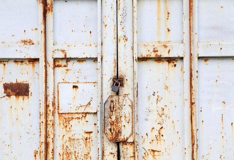 Full Frame Shot Of Locked Old Metallic Door