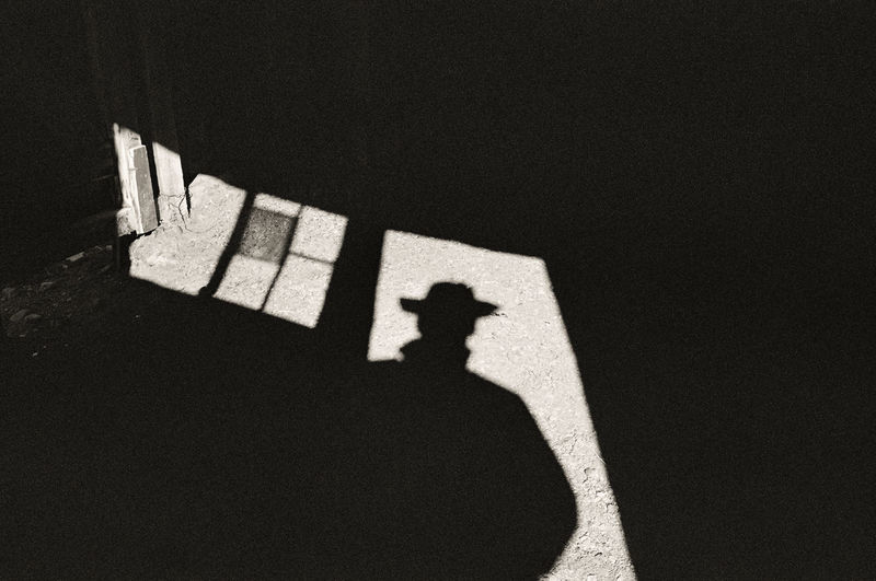 Film Grain Black And White Monochrome Rurex Abandoned Abandoned Places Ranch Farm Barn Window Door Broken Window Shadow Cowboy Man Hat Cowboy Hat Western Drama Stranger Unrecognizable Person Focus On Shadow Grainy Visitor
