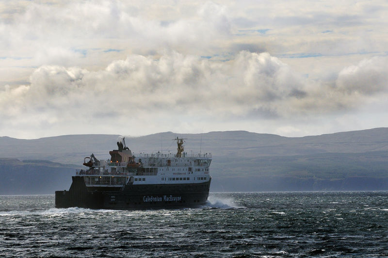 Ferry heads out of Uig on the Isle of Skye heading for the Outer Hebrides Cloud Cloud - Sky Coast Ferry Mountain Mountain Range No People Scotland Sea Ship Sky Skye Transport Transportation Travel Water Weather