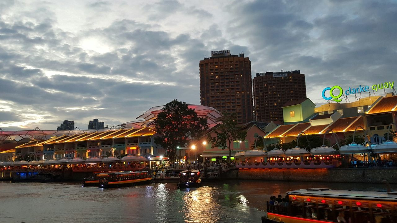 cloud - sky, sky, architecture, building exterior, built structure, river, water, waterfront, city, outdoors, travel destinations, no people, day, multi colored, illuminated, cityscape