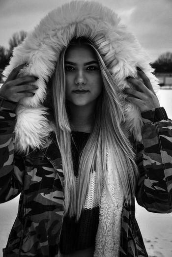 Portrait of young woman wearing hooded jacket