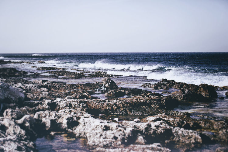 Beach Exploring Horizon Over Water Motion Outdoors Power In Nature Rippled Rock Sea Seascape Shore Splashing Summer Vacation Water Waterfront Wave Windy