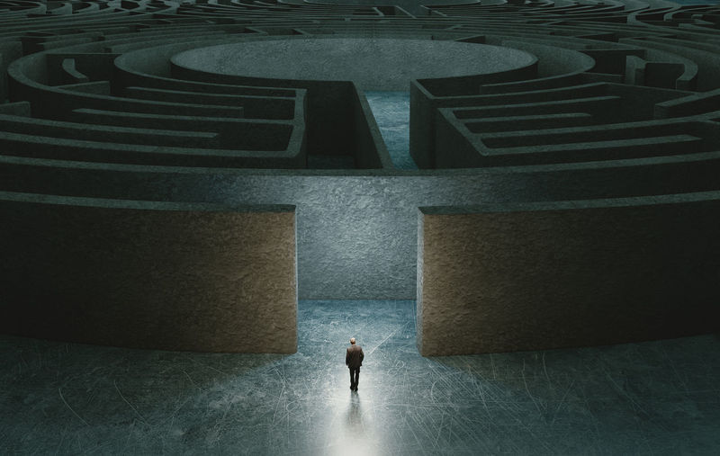 High angle view of man walking in maze