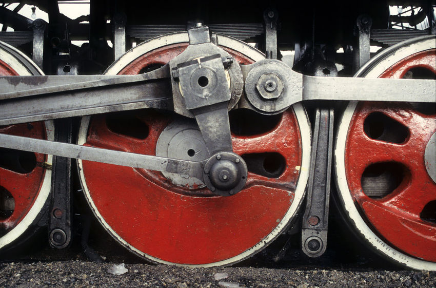 low angle + close up view of drive wheel of steam locomotive Heavy Red Circle Close Up Close-up Connection Day Detail Drive Gear Geometric Shape Industry Iron - Metal Land Vehicle Low Angle Machine Part Machinery Metal Mode Of Transportation No People Outdoors Rail Transportation Red Silver Colored Steam Locomotive Track Train Train - Vehicle Transportation Wheel