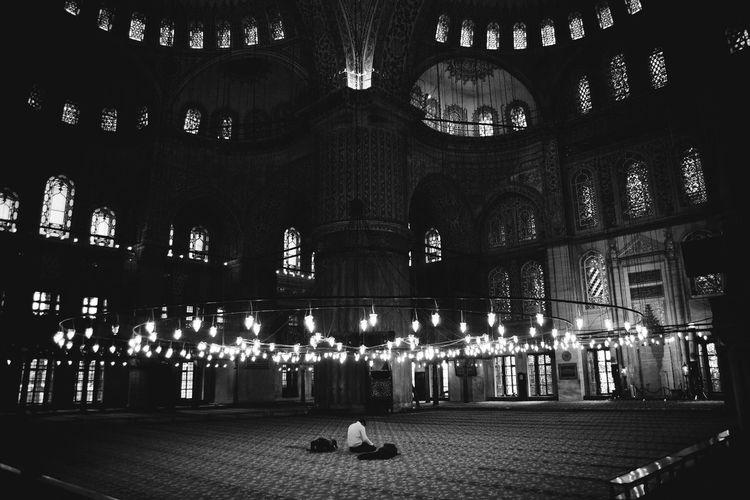 Man in illuminated building at night