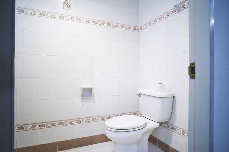 Standard facilities of old generic toilet room of small hotel or apartment with flush toilet with simple ceramic tile pattern decoration Apartment Bathroom Clean Domestic Bathroom Domestic Room Facility Flip Flush Flush Toilet Flushing Toilet Generic Home Hotel Hygiene Indoors  Lavatory Old Public Restroom Sanitary Standard Tile Tiled Floor Toilet Toilet Paper White Color