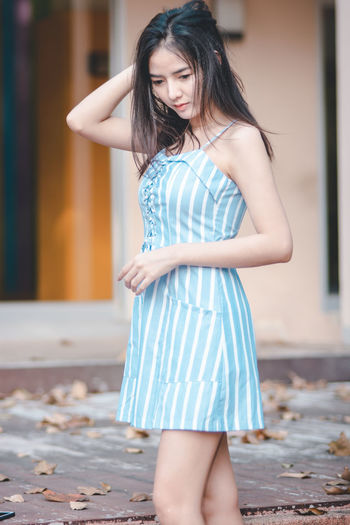 One Person Long Hair Standing Hairstyle Hair Real People Young Adult Women Focus On Foreground Young Women Fashion Three Quarter Length Dress Leisure Activity Beautiful Woman Beauty Day Lifestyles Clothing Outdoors Mini Dress