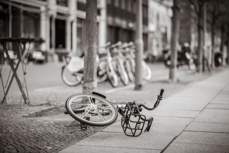 overturned rental bicycle Berlin Cityscape Fahrrad Stadt Travel Bicycle Black And White Day Focus On Foreground Nobody Outdoors Street Tour