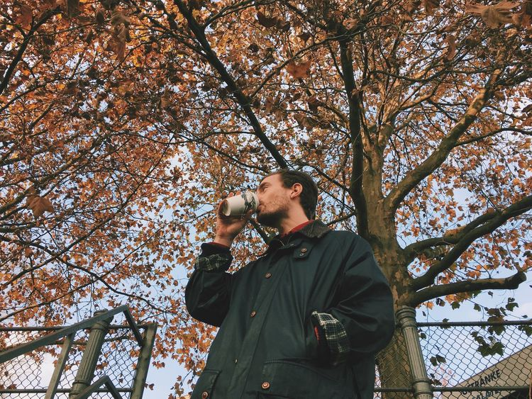 Autumn Young Adult Drinking Coffee Outdoors Low Angle View