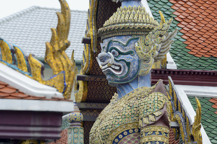 Low angle view of guardian statue at wat phra kaeo