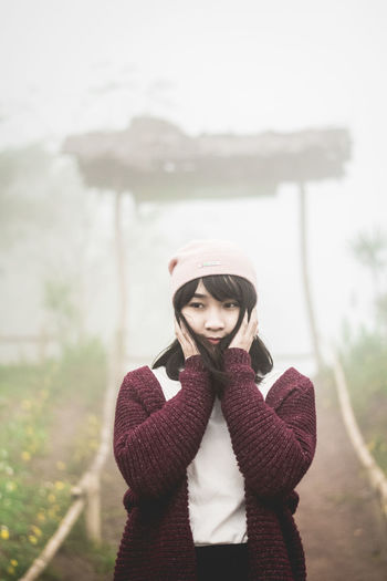 pretty girl Location Doi Sa Ngo Chiang Rai thailand Beautiful Woman Clothing Contemplation Day Focus On Foreground Front View Hat Knit Hat Lifestyles Nature One Person Outdoors Portrait Real People Scarf Standing Sweater Warm Clothing Winter Young Adult Young Women