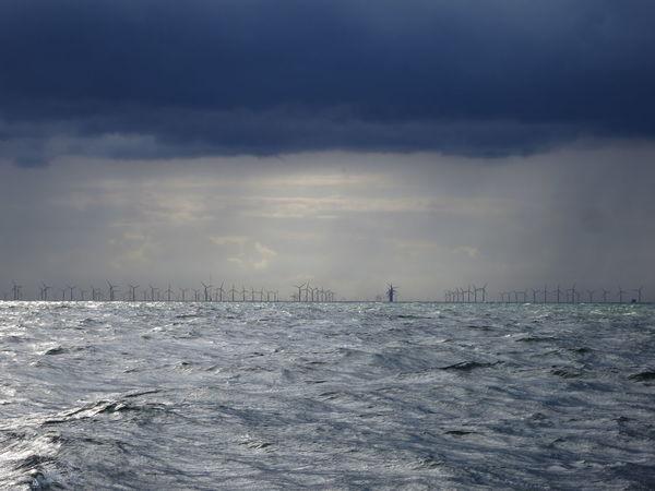 Giants of the sea. Distant Horizon Over Water Offshore Windpark Power In Nature Renewable Energy Sea Sky Water Wind Turbine