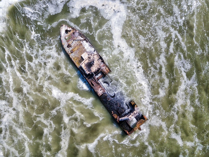 Aerial View Of Abandoned Ship In Sea Against Sky