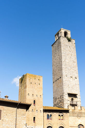 The towers in San Giminano, Italy San Gimignano Tuscany Architecture Blue Building Building Exterior Built Structure Clear Sky Clock Day Fort History Italy Low Angle View Nature No People Outdoors Sky Sunlight Tall - High The Past Tourism Tower Travel Destinations