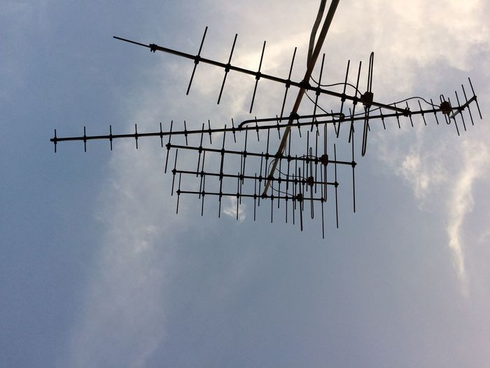 Low Angle View Of Television Aerial Against Sky