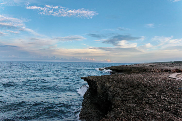 Coastline Sea Water Sky Horizon Scenics - Nature Cloud - Sky Horizon Over Water Beauty In Nature Tranquil Scene Tranquility Rock No People Rock - Object Solid Nature Land Beach Idyllic Motion Outdoors Rocky Coastline Ocean Coastline Island Curacao Antilles Caribbean Travel