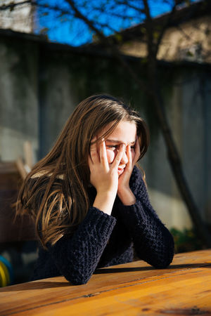A sad and depressed cute little girl sitting outdoors at the and depression concept. Depressed Teen ..  Lonely Pain Pensive Stress Unhappy Depress Depressed Depressing Depression Depression - Sadness Depressive Despair Emotion Frustration Mental Mental Health  Mental Illness Sad Sad Face Sadness Solitude Stressed Unhappy Girl Unhappy Face