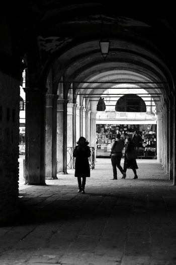Full Length Arch Architecture Walking Built Structure Indoors  Silhouette Adult Corridor Day People Men Women Lifestyles Two People City Real People Adults Only Politics And Government Only Men Black And White Friday