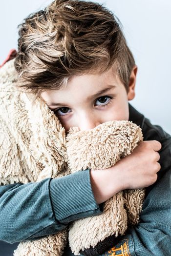 Portrait of boy with toy in winter