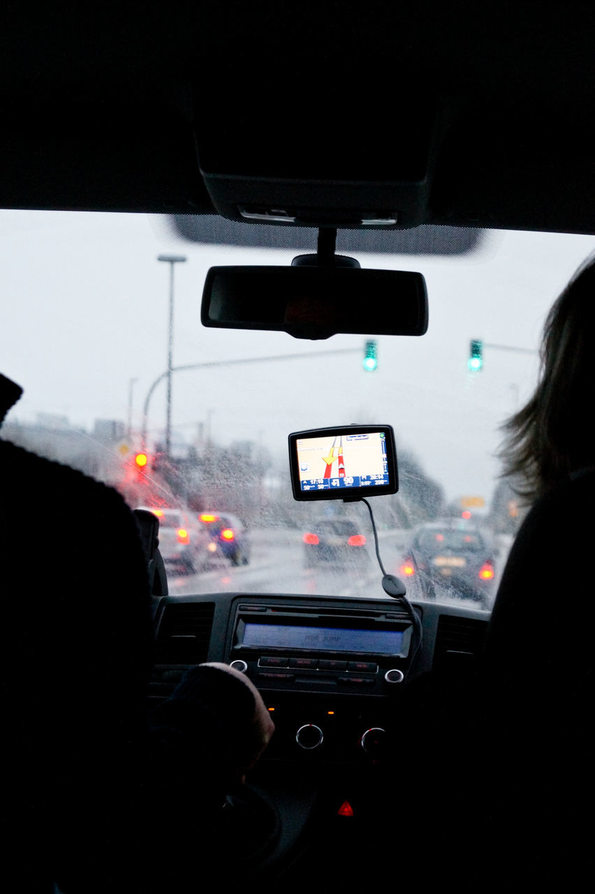 car, transportation, land vehicle, vehicle interior, mode of transport, car interior, windshield, real people, rear view, driving, men, day, one person, outdoors, people