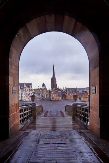Cathedral seen through arch against sky