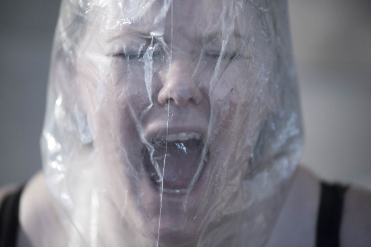 Close-up of woman screaming